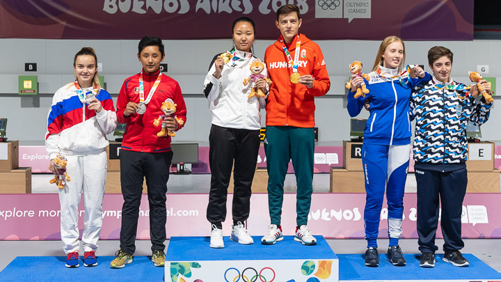 BUENOS AIRES - OCTOBER 11: (L-R) Silver medalist team Anastasiia DEREVIAGINA of the Russian Federation / Edson Ismael RAMIREZ RAMOS of Mexico, Gold medalist team Enkhmaa ERDENECHULUUN of Mongolia / Zalan PEKLER of Hungary and Bronze medalist team Viivi Natalia KEMPPI of Finland / Facundo FIRMAPAZ of Argentina pose with their medals after the 10m Air Rifle Mixed International Team Medal Matches at the Parque Sarmiento Shooting Range inside the Tecnopolis Park during Day 5 of the 3rd Youth Olympic Games on October 11, 2018 in Buenos Aires, Argentina. (Photo by Nicolo Zangirolami)