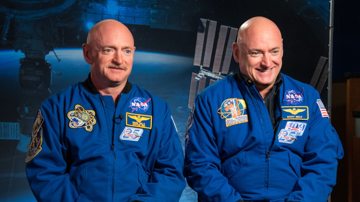 Expedition 45/46 Commander, Astronaut Scott Kelly along with his brother, former Astronaut Mark Kelly speak to news media outlets about Scott Kellys 1-year mission aboard the International Space Station.  Photo Date: January 19, 2015.  Location: Building 2.  Photographer: Robert Markowitz